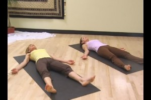 Two women laying on mats doing yoga nidra meditation